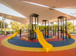 stock photo shaded kid s playground activity tower equipment at the lake park in abu dhabi