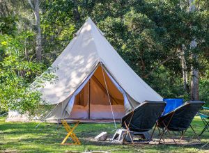 stock photo glamping camping teepee tent and chairs at the campsite