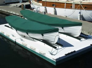 stock photo two white rowboats with green covers on a dock in a harbor in victoria british columbia canada